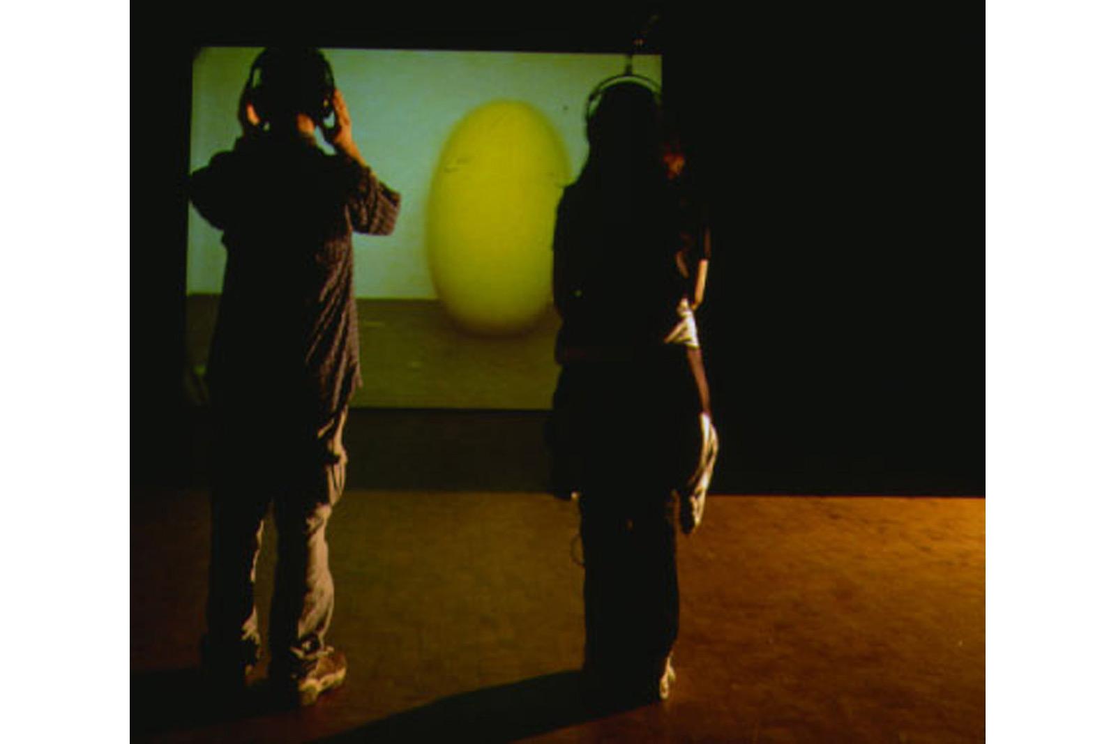 artist dancing inside a yellow airballoon, videoinstallation ZKM Karlsruhe