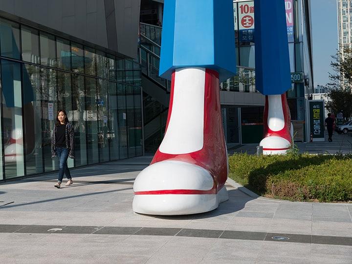 big public sculpture in city metropol big shoes